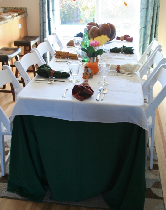 Antique linen over green linen table cloth