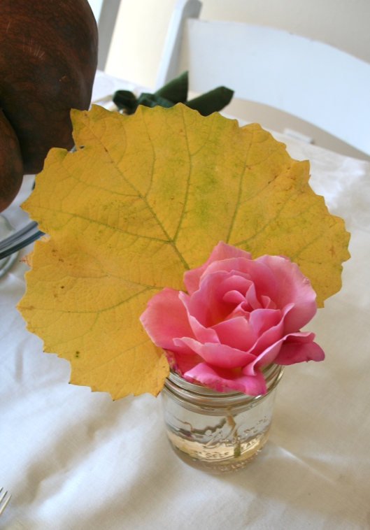 Rose and grape leaf arrangement mason jar